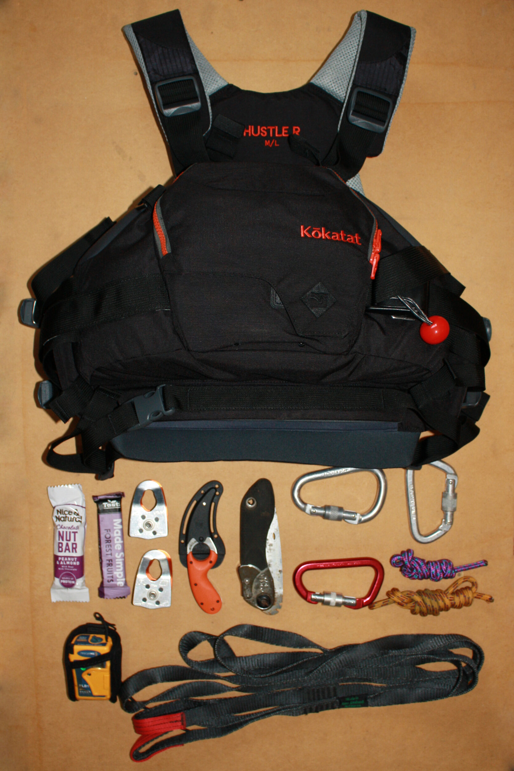 What fits in the pocket of a Kokatat HussleR rescue PFD