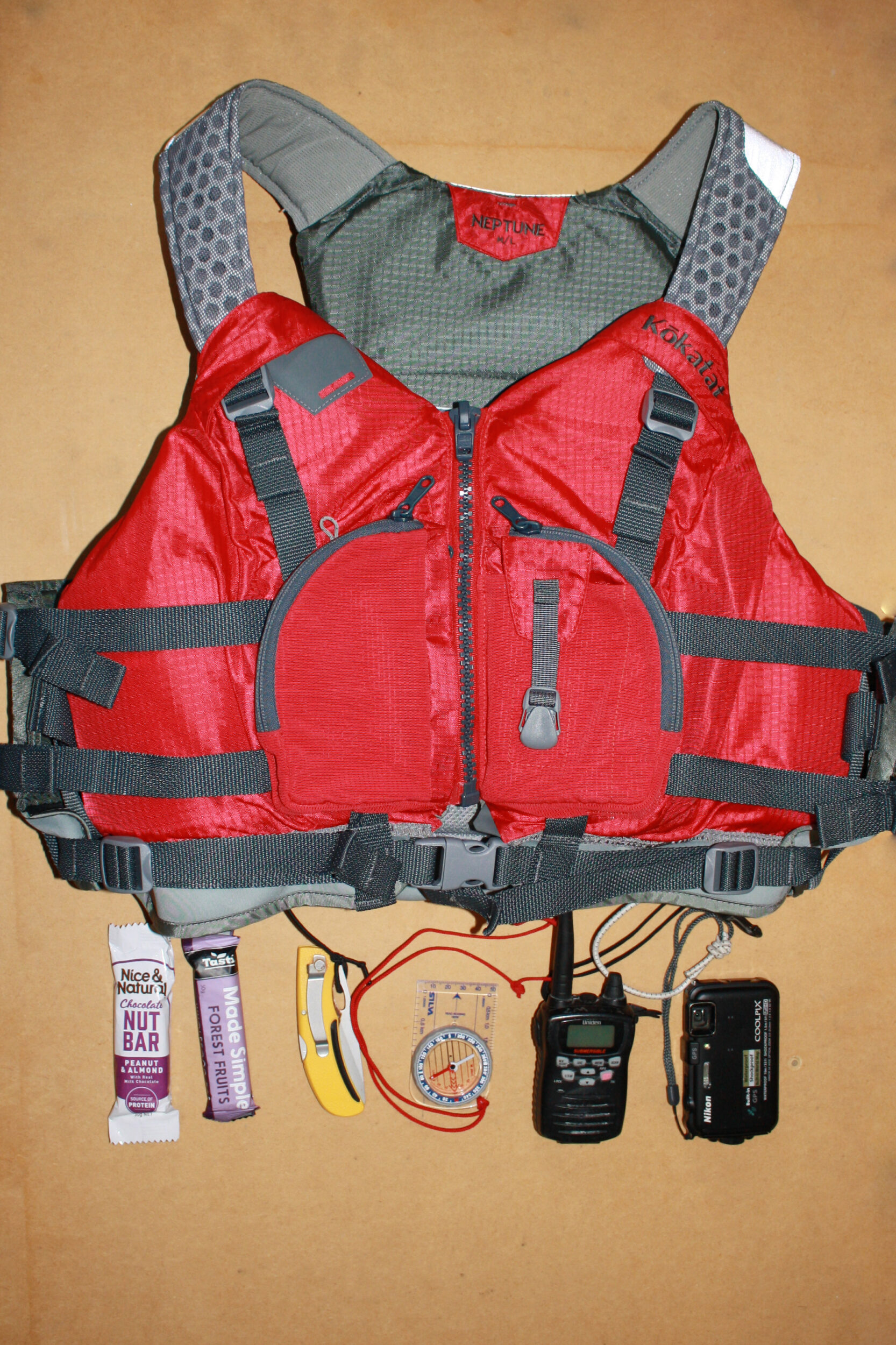 What fits in the pocket of a Kokatat Neptune Sea Kayak PFD