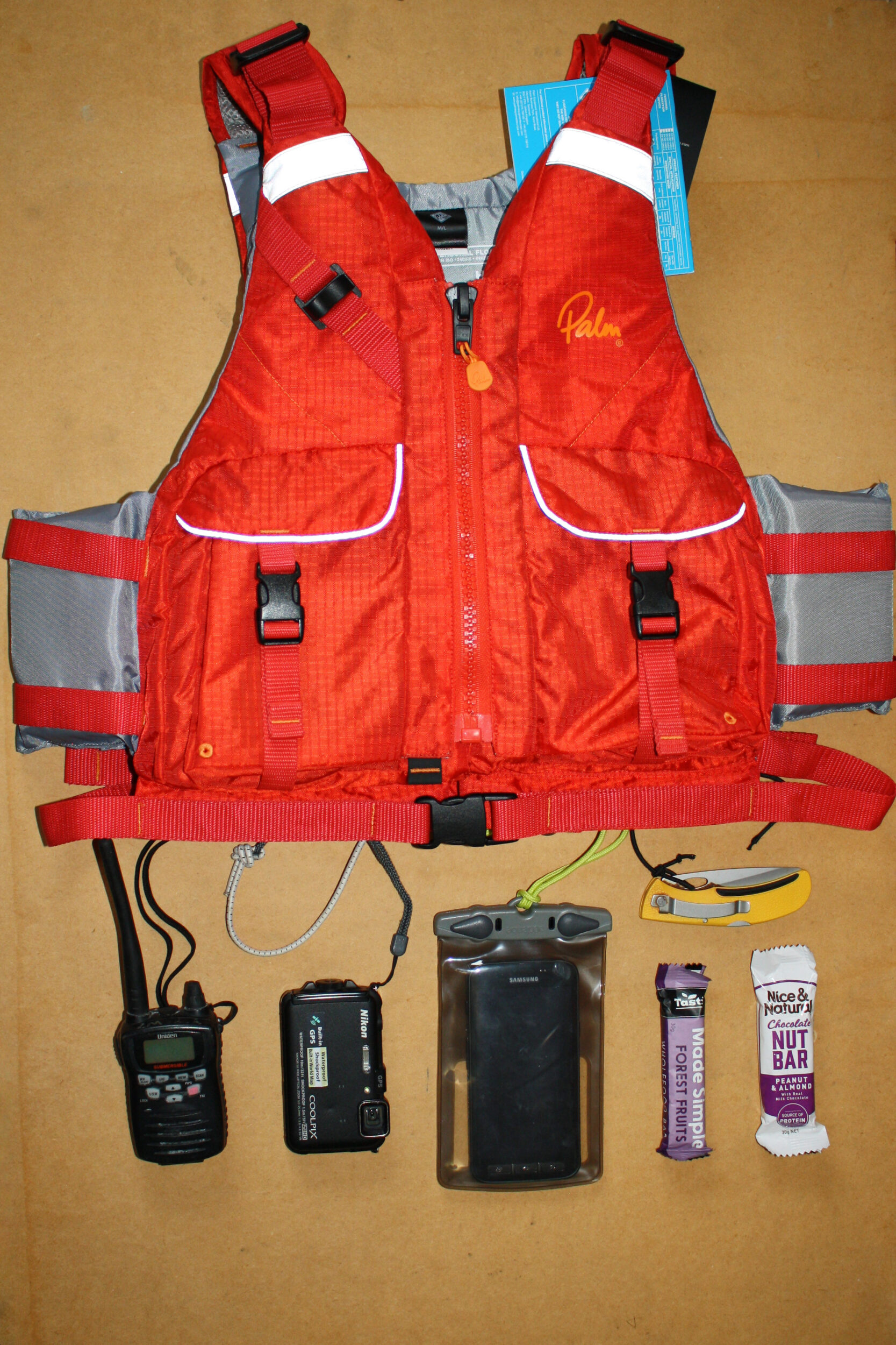 What fits in the pocket of a Palm Hydro Sea Kayak PFD